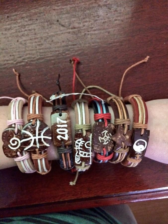 A student displays several bands on their arm.