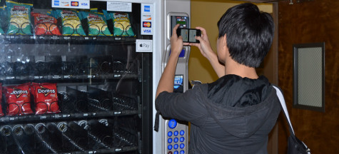 Johnnan Monzon Jr. using new vending machine scanner.