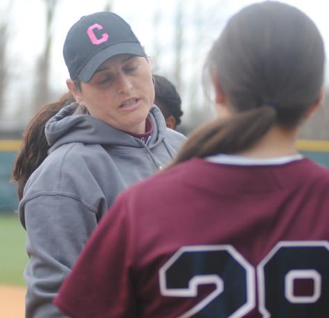 Coaching multiple sports, McNamara speaks to a softball player.