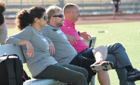Carla Sigona, Coach Gonzalez and athletic director, Eric Ritzer, watch the girls soccer team during a fall practice.