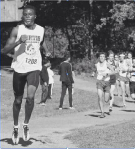 John Akakeya runs ahead of competitors.