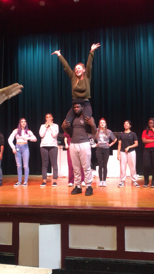 Members of the cast of Legally Blonde rehearsal a number in the Curtis auditorium.